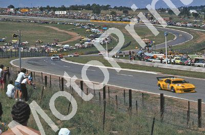 (thanks to Stuart Falconer) a 696 1979 Wynns 1000 Jukskei M1 Stuck M Winkelhock, Escort further back