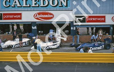(thanks Stuart Falconer) a 796 1982 SA GP Tyrrell 011 pits #3 white and blue cars Alboreto; #4 white Borgudd
