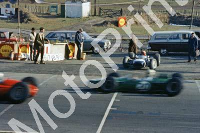 1965 a4 11 Jo Siffert Brabham BRM BT11 enters circuit; Bob Anderson Brabham Climax passes (courtesy Roger Swan) 034