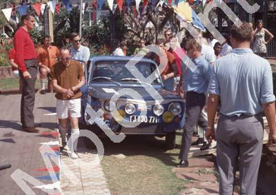1969 Total Rally d 23 Chris Swanepoel, Gus Crous R8 dinged Scamp at RH door, MIke Cole at LH door (Ben van Rensburg) (1)